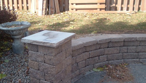 Weathered Chestnut Versa-Lok seating wall with Pillars in Burnsville