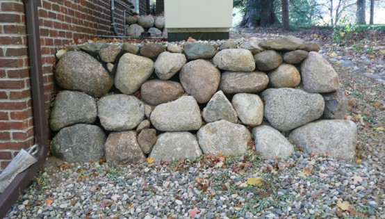 Glacial boulder support wall in edina - Natural stone wall solutions ...