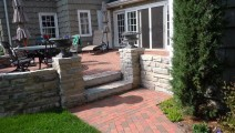 Chilton stone mortared retaining wall and pillars, clay paver patio in Minneapolis