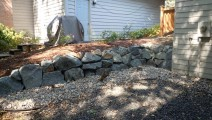 Blue trap boulder retaining wall in Apple Valley