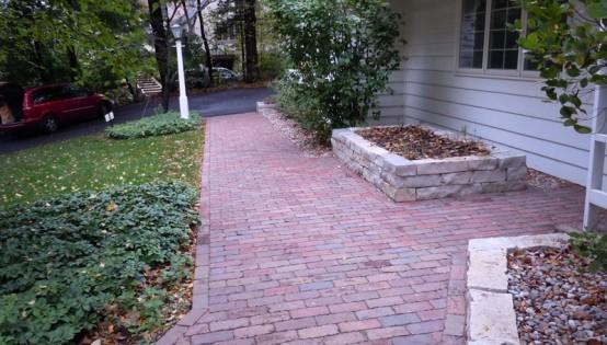 Reclaimed Purrington paver sidewalk and Fond Du Lac planter